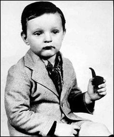 """Alan Alda Original caption from Toronto newspaper: Alphonse Robert Alda at the age of two years and three months finds solace from worldly cares in a briar pipe."""" A publicity stunt to support his fathers vaudeville act. Celebrities Then And Now, Young Celebrities, Celebs, James Spader, Young Ones, Young People, Celebrity Babies, Celebrity Photos, Alan Alda"""