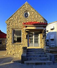Tiny Stone Cottage in Excelsior Springs, Missouri USA | Photo by Bob Travaglione via Flickr
