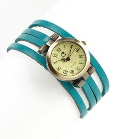 A vintage case defines this very fashionable wrap watch, complete with roman numerals and a cream dial. Supple leather straps wind around the wrist, securing it in modern-meets-retro style.