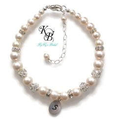 SHOP NOW ~ https://www.etsy.com/listing/202513280/bridal-bracelet-personalized-bridal Personalized Bridal Bracelet Handstamped with her initial.