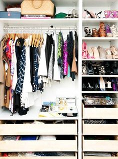 9 Tips For Beautiful Organization // custom closet with wooden shelves, shoe shelves, and wooden drawers