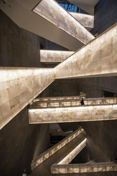 Alabaster-clad bridges link the galleries within the Canadian Museum for Human Rights, and become illuminated at night.