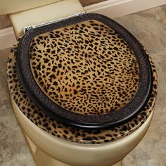 Dynasty Toilet Seat _ The resin Dynasty Toilet Seat features a Cheetah Print Design in the handpainted colors of tan and brown.