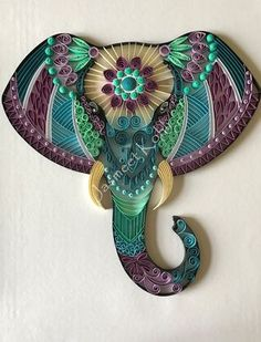 "This beautiful and unique Elephant head artwork is made by glueing 1/4 inch card stock paper strips to card stock/cardboard base in a Zentangle design. The artwork is ready to be framed in 11""x14"" shadow box frame or a deep frame. This decorative piece"