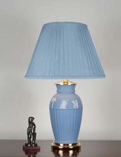 "A vintage Wedgwood, pale blue, jasper lamp.  The lamp of classic style,   the upper third decorated with white jasper bas-reliefs  of subjects derived from classical Greek art.   These bas-reliefs having been originally modelled for Wedgwood   by John Flaxman in 1776-1777.  The lamp seated in a custom made, gold plated bronze base.  Overall height (including shade) 20""/51cm  c1960"