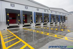 Loading dock cargo doors at big warehouse by Portokalis, via Shutterstock Parque Industrial, Industrial Architecture, Warehouse Design, Warehouse Layout, Visual Management, Factory Architecture, Lean Manufacturing, Steel Frame Construction, Factory Design