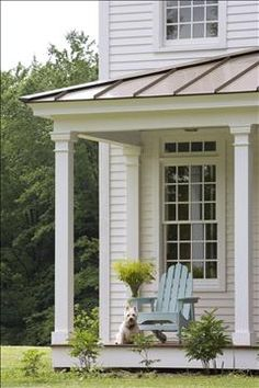 Details of porch posts, window trim, and eaves of the roof.