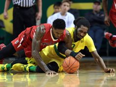 Oregon Ducks forward Dwayne Benjamin, right, and Fresno State Bulldogs guard Lionel Ellison III battle for a loose ball in Eugene, Ore.  Scott Olmos, USA TODAY Sports