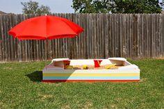 What a great way to add sand to the backyard.   diy backyard sandbox