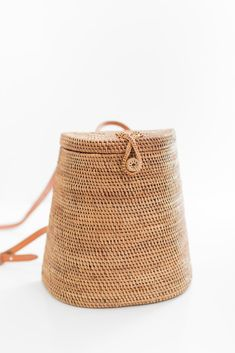 Large handmade rattan backpackwith a adjustable buckle leather straps. Each bag is uniquely handmade by Balinese artisans using locally source materials. This
