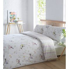 The Scandi bird set from The Collection will add a minimal Scandinavian touch to the bedroom setting. In white, it features a pastel green leaf print, with colourful birds flocking throughout. It's also reversible, the other side showcasing pastel vertical candy stripes for a touch of something different.