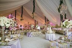 lovely tented with draped soft fabric. A romantic reception.