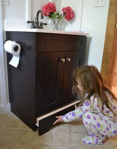 Ana White | Build a Vanity Step Drawer | Free and Easy DIY Project and Furniture Plans..... Turn a builder grade vanity into a child friendly vanity by converting the toekick to a step drawer. Also could be used to create a storage drawer, increasing the storage in the bathroom.
