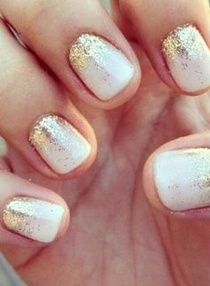 White with gold sparkle nails.