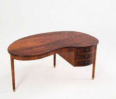 Rosewood desk with kidney shaped top and elegant details | From a unique collection of antique and modern desks at http://www.1stdibs.com/furniture/storage-case-pieces/desks/