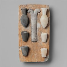 "Model of the ""Opening of the Mouth"" ritual equipment    Period:      Old Kingdom  Dynasty:      Dynasty 5–6  Date:      ca. 2465–2150 B.C.  Geography:      Egypt  Medium:      Tray: limestone; vessels: Egyptian alabaster, greywacke"