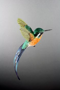 Handmade paper and plastic resin hummingbird by ZackMclaughlin