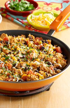 Chicken Burrito Skillet - Chicken, black beans, zesty tomatoes and taco seasoning cooked together with brown rice for an easy burrito skillet topped with cheese