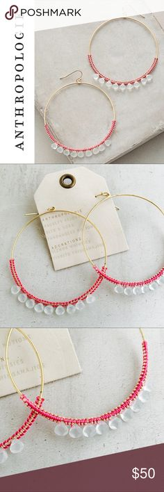"ANTHROPOLOGIE Stone Hoops Large, delicate wire hoops wrapped with coral colored threading and adorned with semi-opaque beads.   * Brass, polyester, glass      * Imported * 2.75"" diameter Anthropologie Jewelry Earrings"