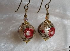Lustrous, with the beauty of metal cloisonne beads, these earrings are made from incredibly light & comfortable Decorated Cotton Pearls. Cotton Pearls are difficult to find and Decorated Cotton Pearls are quite rare and unique.   These earrings feature 14mm or 16mm Cotton Pearl beads decorated with vintage-like dark pink roses, accented by 4mm Bicone Crystals.  See these earrings and more at our ETSY shop:  etsy.com/shop/FireMonkeyDiva  #FireMonkeyDiva