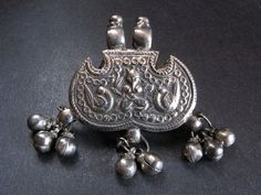 Antique silver Ganesha tiger claw pendant from India.
