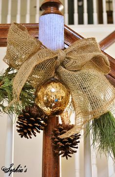 Burlap, gold, pine cones and greenery.