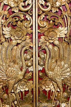 Image of intricate wood carving on a temple door at Pura Masceti, Bali, Indonesia.