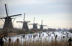 Ice Skating on a canal in Kinderdijk, Holland