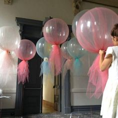 This is what balloons look like covered in tulle, except I'd probably make the bottom hang down longer to give more layers to play with. It would essentially look like curtains that are hanging by balloons. Shower Party, Baby Shower Parties, Bridal Shower, 1st Birthday Parties, Girl Birthday, Tulle Balloons, Clear Balloons, Deco Ballon, Fiesta Baby Shower