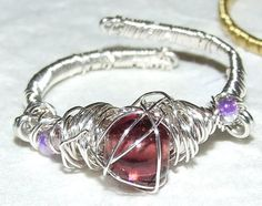 Silver wire wrapped adjustable size ring with purple glass bead. on Etsy, £4.00