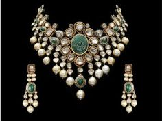 Gehna Jewellers Rocks: Carved emerald, south sea pearl, and uncut diamonds on 22k gold Price on request Available at Gehna Jewellers, Turner Road, Bandra, Mumbai