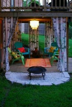 This is a great way to use the vacant space under a second story deck. Rather than just keep junk under there - turn it into another gathering space!