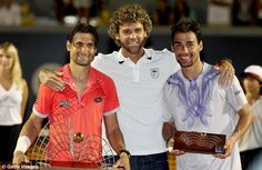 Former world No 1 Gustavo Kuerten (centre) poses for a picture with finalists Ferrer (left...