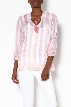 Sheer loose fit top with three-quarter length sleeevs and tassel tie closure  on v-neckline. White top with pink, coral and purple vertical print detail. f2ac947bd8