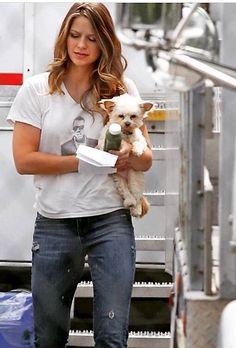 """Superpuppy carrying puppy (aka Melissa Benoist and Milli) I'm bouncing back and forth between """"awww a puppy holding a puppy"""" and """"choke me with your arms."""""""