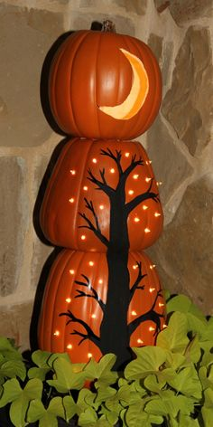 cute idea for stacked pumpkin topiary - paint black tree on bottom two with holes drilled in for stars and carve a crescent moon on top one.