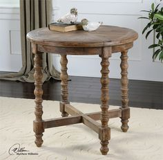 "Between two leather chairs in family room! It's 26"" wide and 26 "" high.  Uttermost Samuelle Wooden End Table"