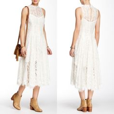 """Free People ivory white lace dress NWT A sleeveless crew neck midi is cut entirely from lace and styled with a back keyhole. - Crew neck - Sleeveless - Hidden side zip closure - Back button keyhole closure - Lace construction - Lined - Approx. 47"""" length - Imported Fiber Content: Body: 85% cotton, 25% nylon Lining: 100% rayon Free People Dresses Midi"""