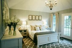 Fixer Upper Bedroom. Beautiful! Soothing color palette. Love the 3 pictures above the bed too! :)