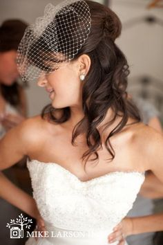 Mrs. Turtle -- half-up, curled, vintage-inspired wedding hair with a birdcage veil. Photo by Chloe Murdoch.