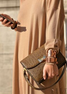 love the line of the dress. Rose gold bangles and ostrich purse beautiful too x