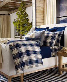 Blue plaid layered bedding with a simple green tree in the room. Very inviting. Ralph Lauren Winter Harbour Collection | macys.com