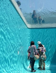 Fake Swimming Pool   Location: Art installation in 21st Century Museum of Art, at Kanazawa Japan  Designed by: Leandro Erlich  Description: The fake pool is a room with a ceiling made up of suspended glass which holds a 10 centimetre depth of water, creating the illusion for the people on top that they are looking into a swimming pool.    Inside the pool is lined with aquarium walls and a space for people to enter