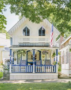 This colorful and tiny carpenter gothic cottage is found in Oak Bluffs, Massachusetts on the island of Martha's Vineyard. Photo: Brian Vanden Brink.