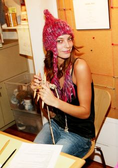 Model Daria Werbowy knitting and wearing a pretty cool chunky wool hat.