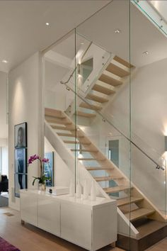Perfect way to showcase the stairs. The glass wall added to the architecture o the space.