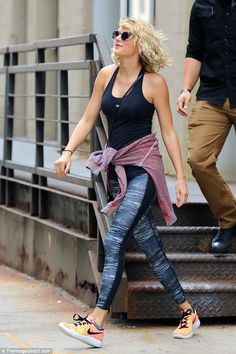 No regrets? Taylor Swift smiled as she stepped out in New York on Tuesday…