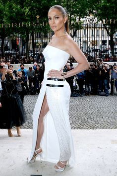 The Weekend's Must-See Snaps!: Jennifer Lopez turned heads at the Atelier Versace fashion show in Paris on Sunday, showcasing a white dress during the city's famed Fashion Week.