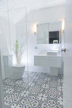 tile flooring for bathrooms this beautiful white bathroom design has combined a modern white vanity unit and toilet with a more traditionally inspired pattern tiled floor marble tile bathroom floor id Bathroom Tile Designs, Bathroom Floor Tiles, Bathroom Design Small, Bathroom Interior Design, Basement Bathroom, Bathroom Cabinets, Bathroom Gray, Mosaic Bathroom, Bathroom Ideas White