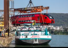 "Today in the ""Au harbor"" of Muttenz near Basel, the first six cars of the first doubledeck trainset for Aeroexpress (Moscow), built by Stadler Rail in Altenrhein/Switzerland, were loaded to the Rhine ship ""Miranda"", which will bring the train to Amsterdam. Then the six cars go with another ship to Mukran on Rügen/Germany, where the train is coupled together the first time in the harbor on a russian broad gauge track (1524 mm)."